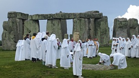 Druids celebrating at Stonehenge by sandyraid